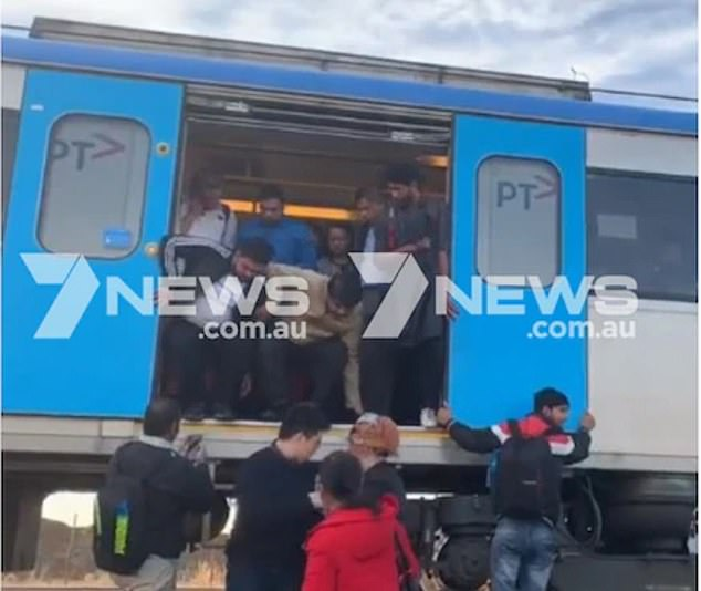 Passengers have reportedly smashed windows and wrenched open doors to escape from a stranded train outside Melbourne