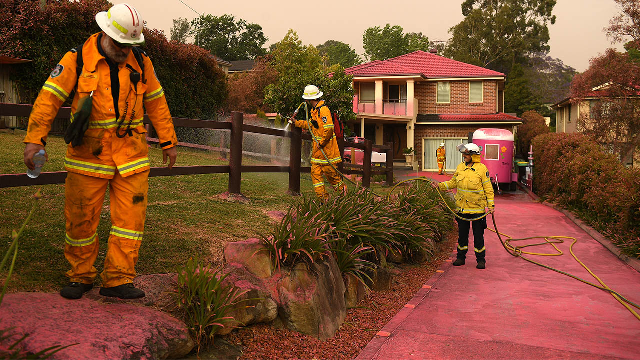 Chemical fire retardant covers the houses on Canoon Rd and Barwon Avenue South Turramurra as firefighters prepare.